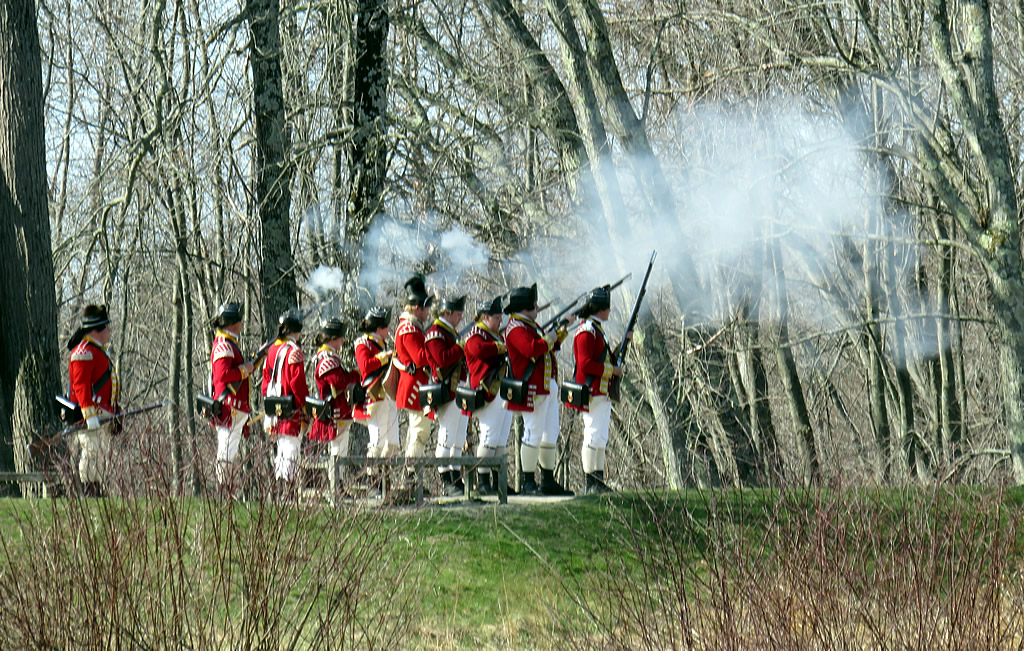 Redcoats fire muskets on Patriots Day