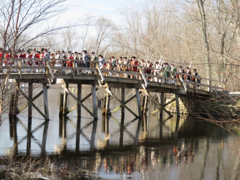 Minutemen march over Old North Bridge on Patriots Day