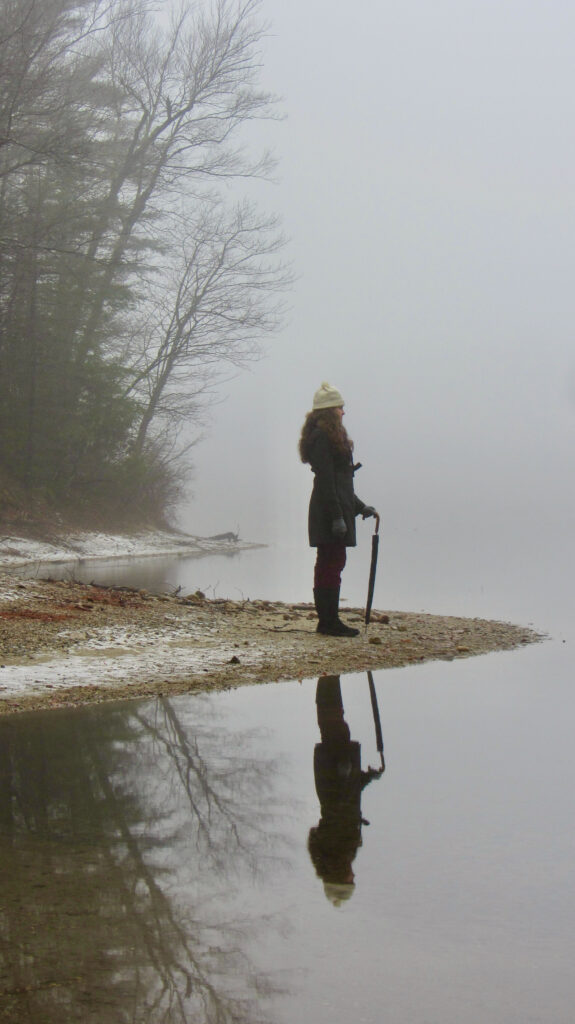 Visitor to Walden Pond in winter