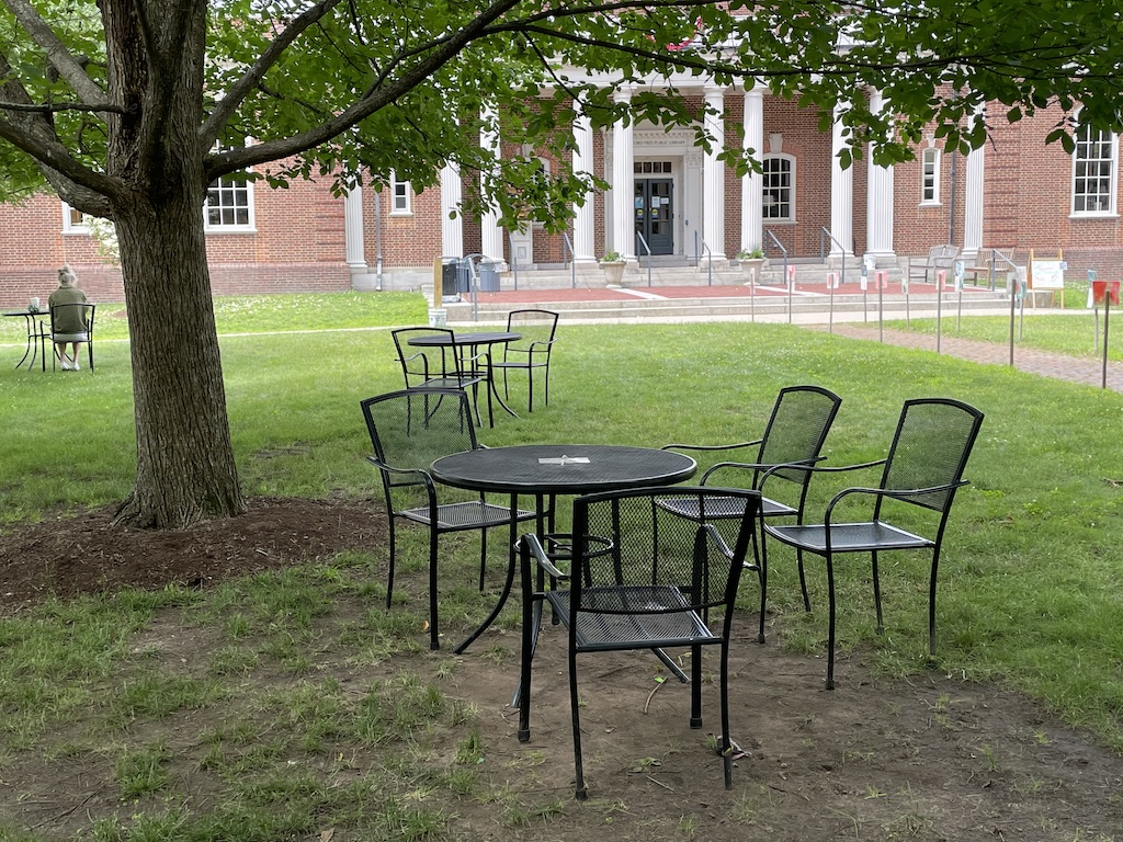 Tables & chairs on library lawn